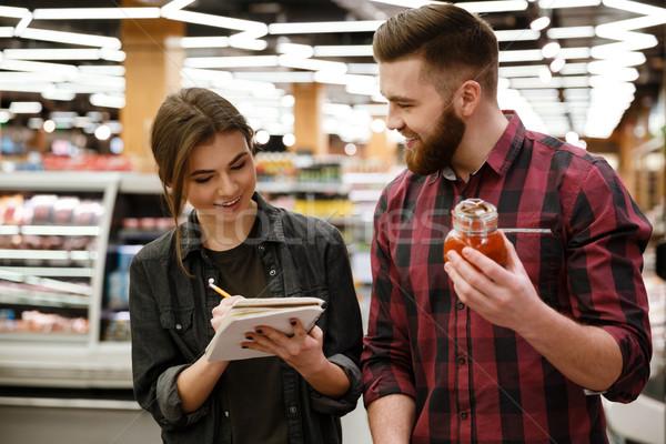 Glücklich jungen liebevoll Paar Supermarkt Auswahl Stock foto © deandrobot
