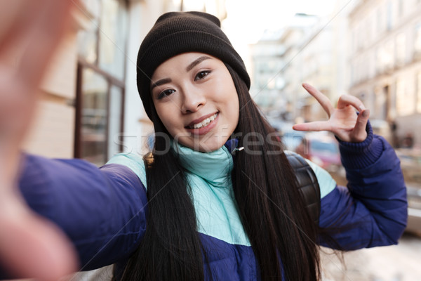 Asian woman in warm clothes making selfie Stock photo © deandrobot