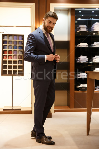 Full length portrait of smiling man in shop Stock photo © deandrobot
