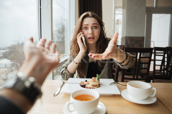 Dissatisfied woman in cafe Stock photo © deandrobot