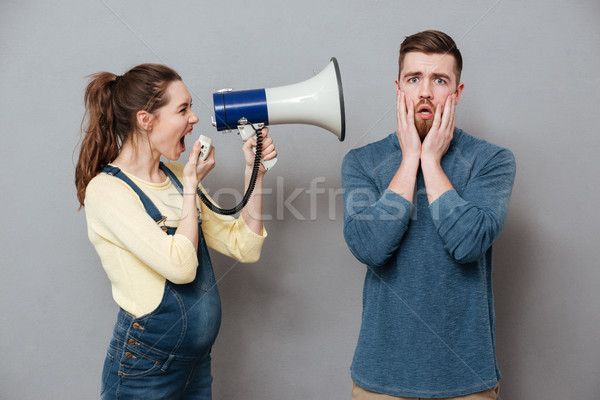 Incinta urlando donna altoparlante piedi Foto d'archivio © deandrobot