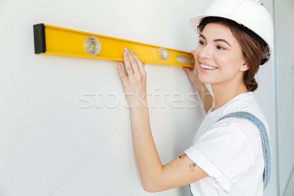 肖像 笑顔の女性 ビルダー 黄色 ストックフォト © deandrobot