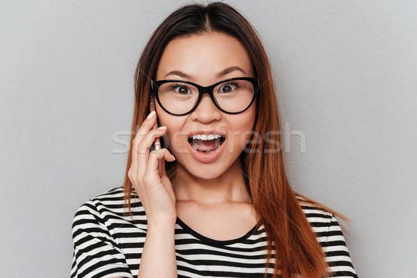удивленный молодые азиатских женщину говорить телефон Сток-фото © deandrobot