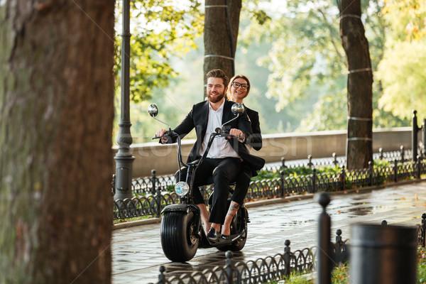 Full length image of young elegant couple rides on motorbike Stock photo © deandrobot