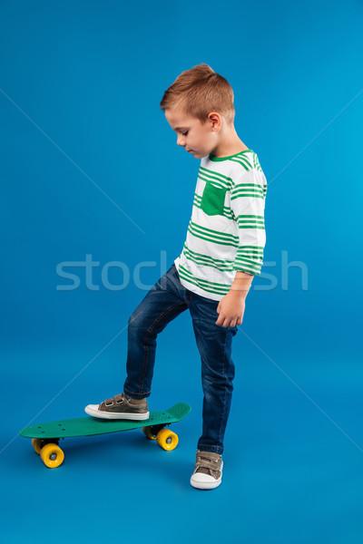 вид сбоку позируют скейтборде студию Сток-фото © deandrobot