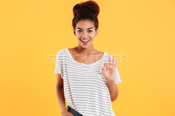 Derűs afrikai hölgy göndör haj mutat ok Stock fotó © deandrobot