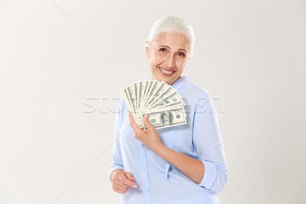 Belo sorridente idoso senhora ventilador Foto stock © deandrobot