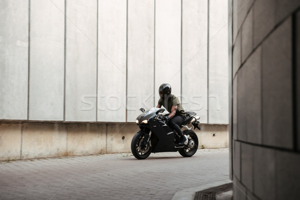Portrait of a young afro american man in helmet riding Stock photo © deandrobot