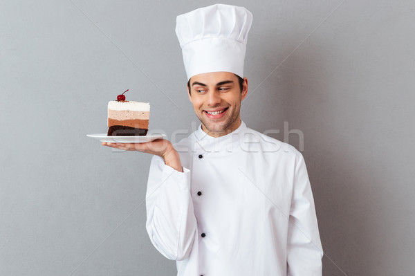 Portrait of a smiling male chef dressed in uniform Stock photo © deandrobot