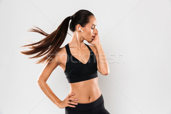 Portrait of a young sensual asian fitness woman Stock photo © deandrobot