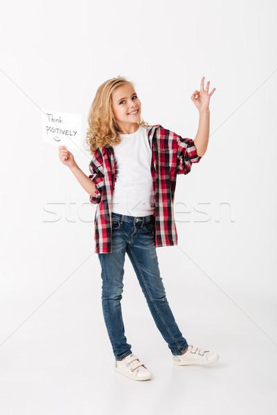 Full length portrait of a smiling little girl Stock photo © deandrobot