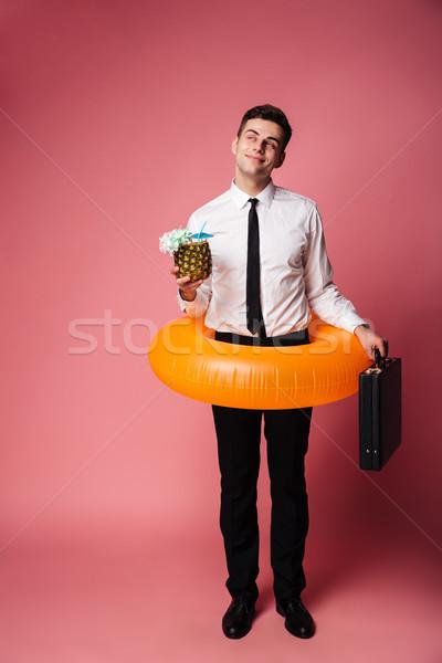 Derűs fiatal üzletember gumi gyűrű álmodik Stock fotó © deandrobot