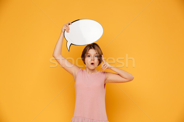 Thoughtful serious girl holding bubble speech over head isolated Stock photo © deandrobot