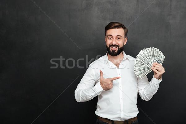 Portret dorosły człowiek biały shirt stwarzające Zdjęcia stock © deandrobot