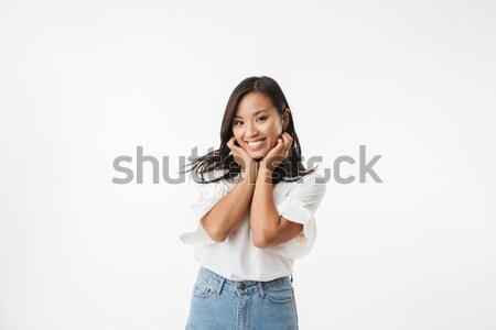 Elégedett nő pózol kar arc másfelé néz Stock fotó © deandrobot