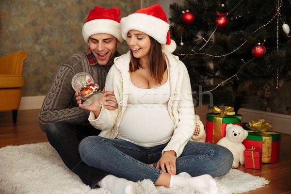 Boldog terhes nő férj visel karácsony sapkák Stock fotó © deandrobot