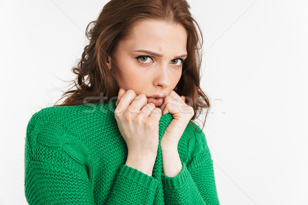 Close up portrait of a scared young woman Stock photo © deandrobot