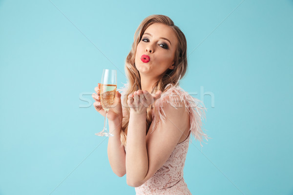 Happy sensual blonde woman in dress posing with champagne Stock photo © deandrobot