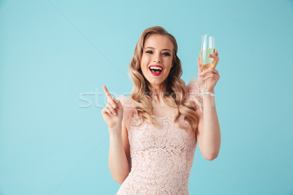 Playful cheerful blonde woman in dress having fun with champagne Stock photo © deandrobot