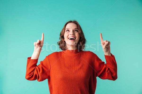 Retrato excitado suéter senalando dedos Foto stock © deandrobot