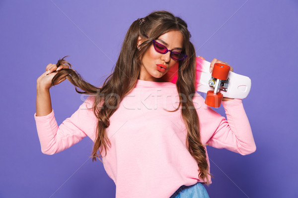 Portrait of a cute girl in sweatshirt posing Stock photo © deandrobot