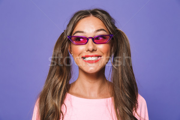 Portrait of a smiling girl in sweatshirt in sunglasses Stock photo © deandrobot