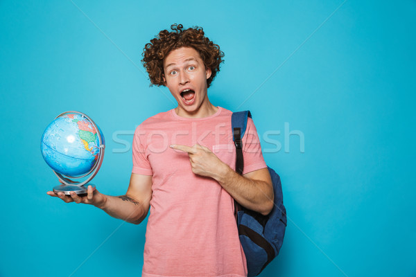 Portrait of geek boy 18-20 with curly hair wearing backpack hold Stock photo © deandrobot