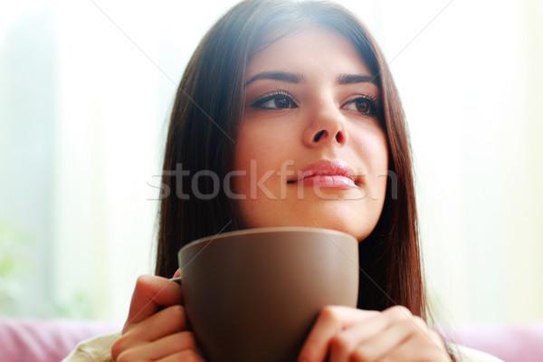 Portret jonge nadenkend vrouw beker Stockfoto © deandrobot