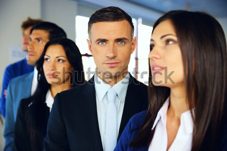 Group of young co-workers standing in a row at office Stock photo © deandrobot