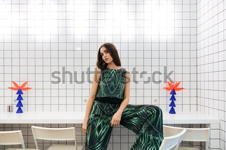 Portrait of a cheerful woman leaning on the colourful chair Stock photo © deandrobot