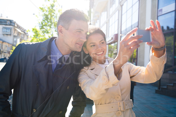 Cheerful couple making selfie photo in the city Stock photo © deandrobot