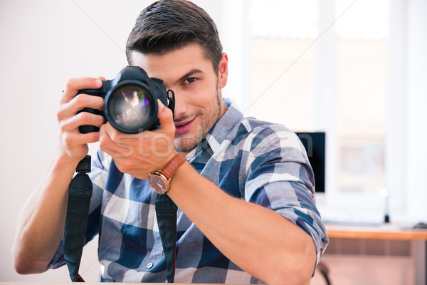 Man shooting with photo camera Stock photo © deandrobot