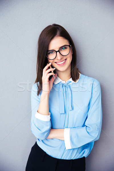 Smiling businesswoman talking on the phone Stock photo © deandrobot