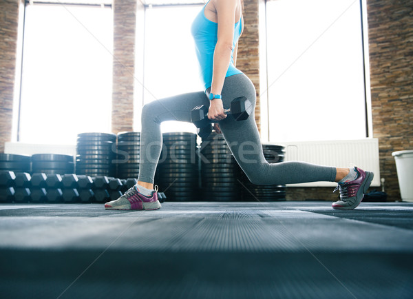 Closeup image of a woman working out with dumbbells Stock photo © deandrobot