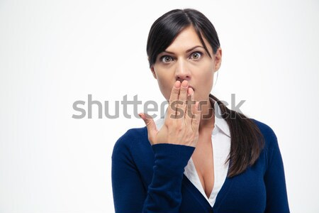 Amazed businesswoman looking at camera  Stock photo © deandrobot