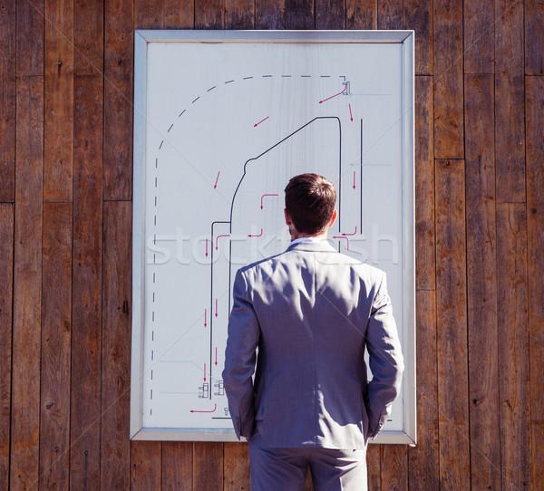 Empresario mirando aparcamiento cabina plan vista posterior Foto stock © deandrobot