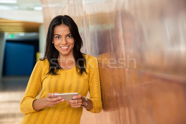 Casual businesswoman using smartphone Stock photo © deandrobot