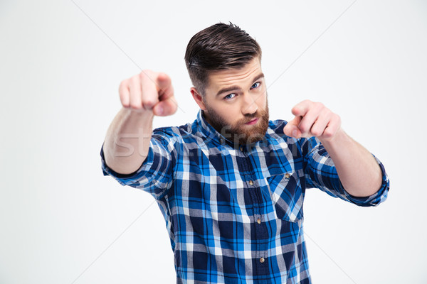 Handsome man pointing fingers at camera Stock photo © deandrobot