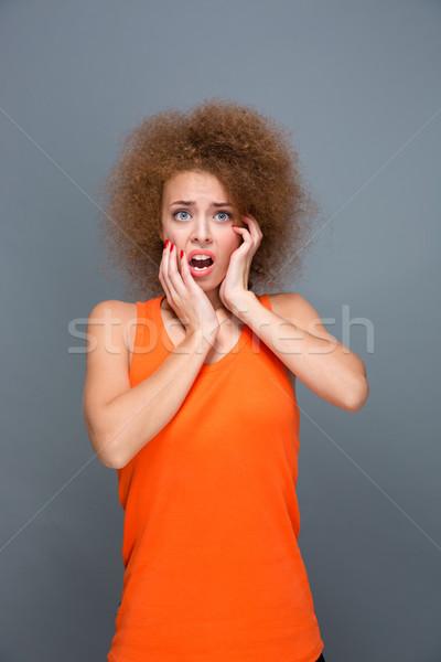 Portré ijedt fürtös lány megrémült félő Stock fotó © deandrobot
