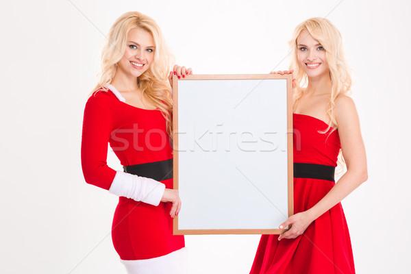 Kettő nővérek ikrek mikulás ruházat tábla Stock fotó © deandrobot