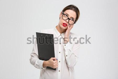 Sfinito stanco giovani donna d'affari occhiali appunti Foto d'archivio © deandrobot