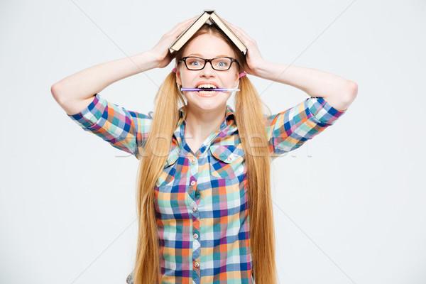 Vicces női diák könyv fej harap Stock fotó © deandrobot