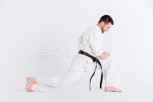 молодым человеком кимоно вверх портрет изолированный Сток-фото © deandrobot