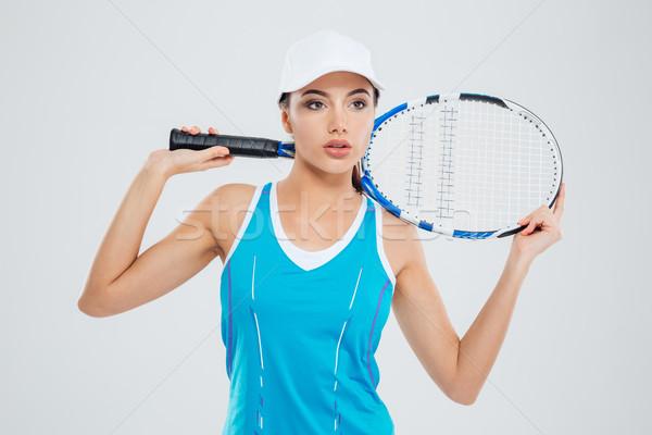 Peinzend sport vrouw permanente tennis geïsoleerd Stockfoto © deandrobot