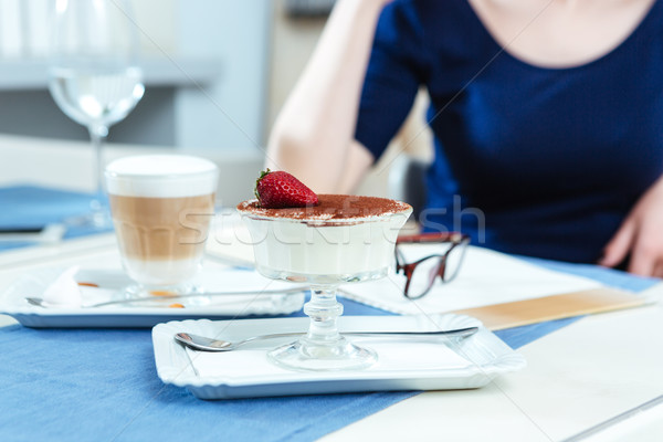 Sweet dessert and coffee latte for woman sitting in cafe Stock photo © deandrobot