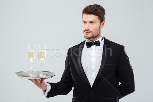 Butler holding silver tray with two glasses of champagne Stock photo © deandrobot