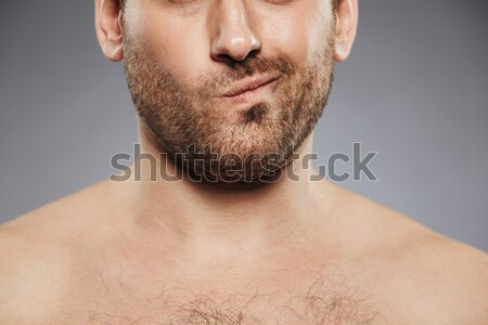 Close-up portrait of man removing nose hair with tweezers Stock photo © deandrobot