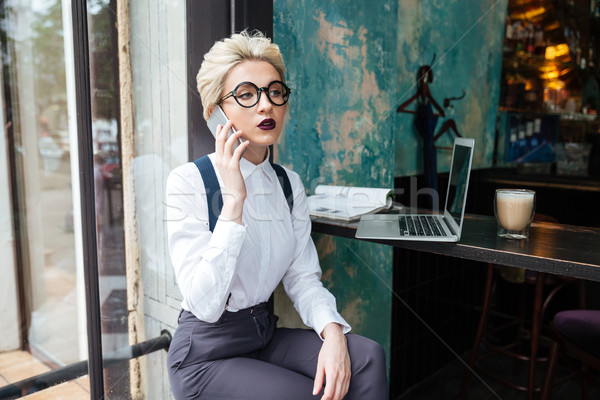 Businesswoman working in a cafe Stock photo © deandrobot