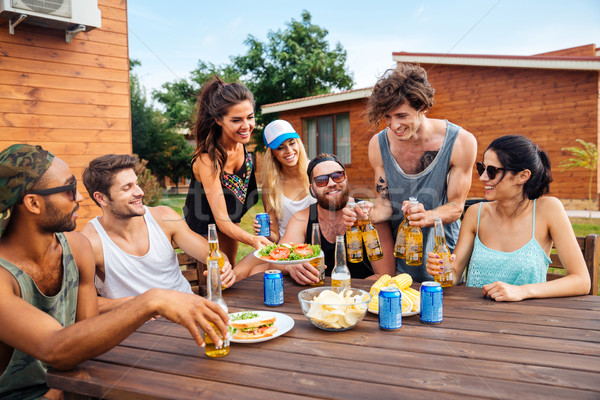 Teenage friends having picnic party outdoors Stock photo © deandrobot