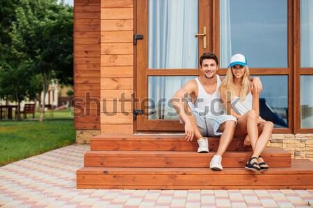 Mutlu çift oturma sundurma ahşap ev Stok fotoğraf © deandrobot